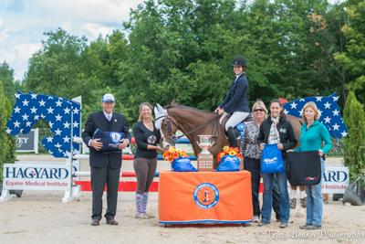 Grace Knox and Rapidash receive their awards with, from left, judge James Zulia, trainers Lisa and Mary Goldman and Drs. Joan Garibold and Kate Lindauer of the Hagyard Equine Medical Institute.