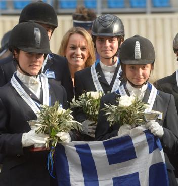The Greek gold medal-winning children's team at the Balkan Dressage Championships (left to right ): Kyveli Tzortzaki, Vassilili Voltairou (partially obscured), chef d'equipe Emmanouella Mousamas, Melina Zografou Alexiou and Lyda-Evdokia Anesti. (Photo: Alexis Vassilopoulos/FEI)
