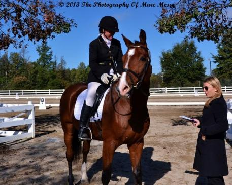 Gwen Poulin helps participant at the Atlanta Youth Dressage Challenge  Photo: Marc Mesa