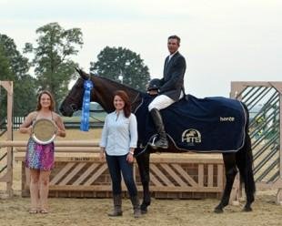 Madeleine Stover of HITS presented Harold Chopping and Caramo with top honors, including a Horze Equestrian cooler, after the $5,000 Devoucoux Hunter Prix at HITS Culpeper. ©ESI Photography