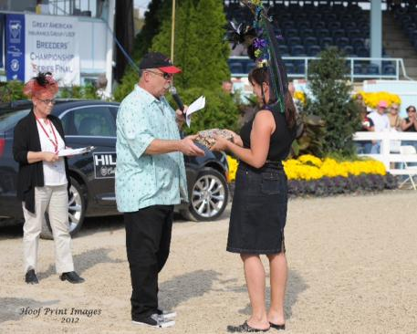 John DeBella, from WMGK 102.9 announced the winners of Hat Day (Photo: Hoof Print Images)