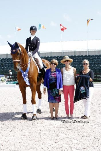 Heather Blitz and Paragon in their winning presentation with judge Joan McCartney, Tuny Page of Stillpoint Farm, and Aliza Korasz of Equestrian Sport Productions. Photo © Susan J. Stickle