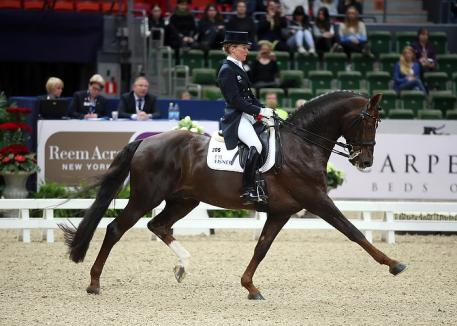 Germany's Helen Langehanenberg and Damon Hill NRW on their way to victory in the Grand Prix. (Photo: FEI/Roland Thunholm.)