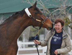 New York Times bestselling author Tami Hoag is all smiles after purchasing her newest equine partner at the Highlife Farms auction. Hoag bought Highlife's Aria, by Highlife's Diamond Stud.