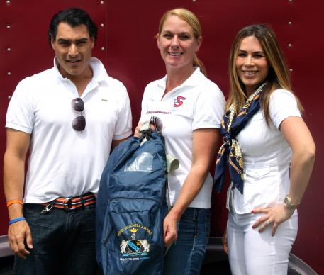 Juan Gonzalez (left) and Dr. Jennine Cabanellas (right) present Melissa Taylor of Legacy Farms with the Wellington Wellness Institute's Rider Wellness Award during the 2013 Adequan Global Dressage Festival 5* CDI.