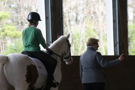 Cecily Byrd, age 12, followed Gerritsen's direction on preparing her horse, Merlin, before transitions.