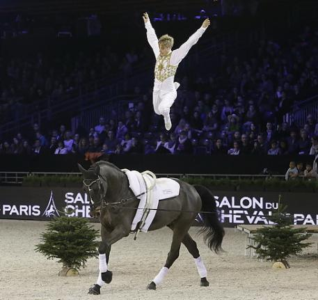 European champion Jacques Ferrari (FRA) vaulted to victory on Poivre Vert, lunged by François Athimon, at the third leg of the FEI World Cup™ Vaulting 2013/2014 at last weekend's Salon du Cheval de Paris event. (Eric Malherbe/FEI).