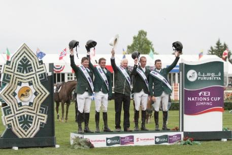 Team Ireland on the podium after their convincing victory in the third and last leg of the Furusiyya FEI Nations Cup™ Jumping North America, Central America and Caribbean League at Spruce Meadows in Calgary, Canada.  L to R - Shane Sweetnam, Darragh Kenny, Chef d'Equipe Robert Splaine, Richie Moloney and Conor Swail.  Photo: FEI/Jennifer Wood Media.
