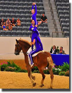 "Jamie Salisbury flies high at the Kentucky Vaulting Cup. She said, ""I'm never nervous because I know that Patrick and Katharine would never let anything happen to me."" (Also pictured; Katharine Wick and Patrick Stevens.) Photo: Alex Thomas"