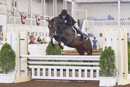 Jennifer Alfano and Candid captured the ,500 USHJA Pre-Green Incentive Hunter Class at the 67th Buffalo International Horse Show with the high score of 87 points. Kendall Bierer/Phelps Media Group.