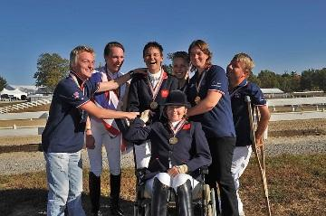 Joanne Pitt, individual bronze and team gold medallist at the 2010 Alltech FEI World Equestrian Games™, is pictured (second right) with her teammates in Kentucky (left to right): Ricky Balshaw, Sophie Christiansen, Emma Sheardown, Sophie Wells MBE, Lee Pearson CBE and Anne Dunham MBE (seated). (Photo: Kit Houghton).