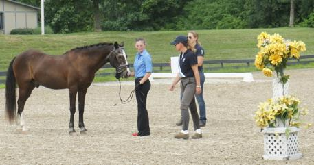 Chelsea DeMeglio presents her pony to Nancy Later Lavoie