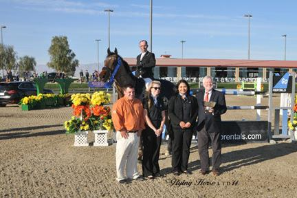 Tony Hitchcock and Chris Mayone of HITS are joined with Go Rentals representatives Karla Zapata and Chrissie Riley to present John Pearce and Son of a Gun with top honors, including a Horze Equestrian cooler, after the ,000 Go Rentals Grand Prix, presented by Zoetis, at HITS Thermal. ©Flying Horse Photography