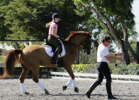 Molly Maloney riding Flyboy, owned by trainer Wes Dunham, with Juan Manuel Munoz