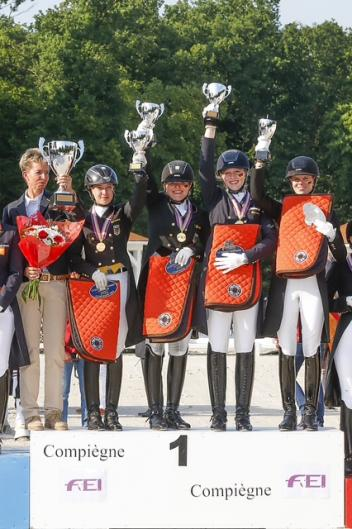 The German gold medal winning Junior team celebrating victory at the FEI European Young Riders and Junior Dressage Championshps 2013 at Compiegne (FRA) (Photo: FEI/Dirk Careman)