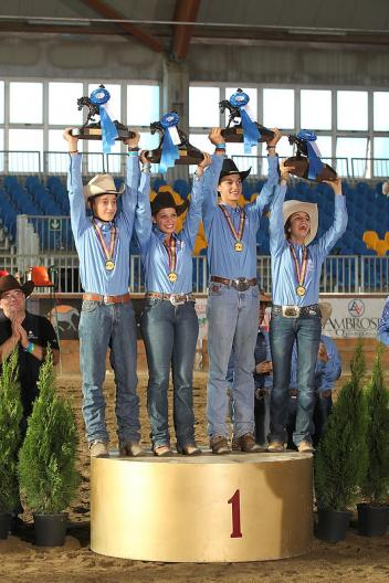 The Italian team of Enrico Sciulli, Linda Rebecca Martinelli, Maddalena Esti and Carlo Ambrosini claimed the Junior Team title at the FEI European Reining Championships for Juniors and Young Riders 2013 in Manerbio, Italy.  Photo: FEI/Andrea Bonaga.