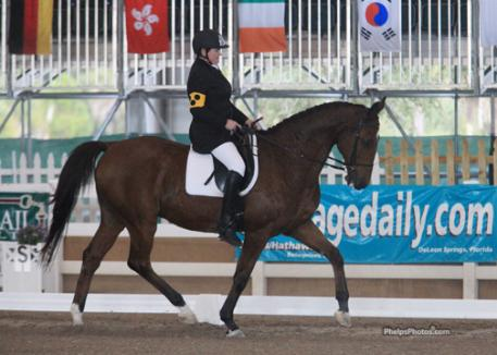 Finland's Katja Karjalainen paired with Margie Engle's former Grand Prix champion jumper Hidden Creek Jones on loan from the Vinceremos Therapeutic Riding Center