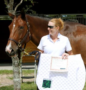Kelly Jennings, of Cocoa, FL and her American Warmblood mare Lexington captured the AA High Score at the Wellington Classic Dressage Fall Challenge I Show