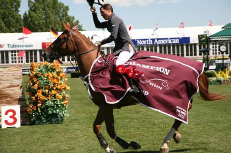 Kent Farrington and Zafira in their round of honor after winning the ,000 G&C Farm Cup. Photo © Spruce Meadows Media Services.