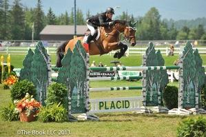 Kevin Babington rides Mark Q to victory in the 0,000 Woodlea Farms Grand Prix