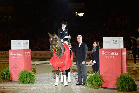 Photo Caption: FEI Director of Dressage, Trond Asmyr, presents the Reem Acra Trophy to Germany's Helen Langehanenberg, winner of today's third leg of the Reem Acra FEI World Cup™ Dressage 2012/2013 series at Stuttgart, Germany.  Photo: FEI/Karl-Heinz Freiler.