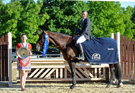 Lindsay Yandon of HITS presents Harold Chopping and Caramo with top honors, including a Horze Equestrian cooler, in the ,000 Devoucoux Hunter Prix at HITS Culpeper. ESI Photography