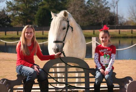 Ashley Waller's 10-year-old daughter Madison and seven-year-old daughter Emily with Listo