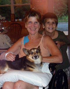 Mary recovering at home with grandson Logan and her corgi, Tahsa.