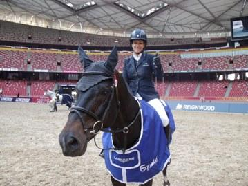 The copyright-free photo shows the winner of the Longines Beijing Masters 2013 Laura Kraut (Photo: Longines Beijing Equestrian Masters).