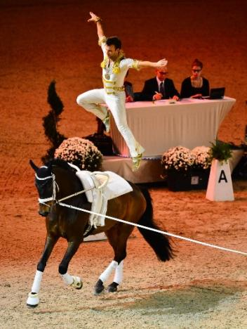 Lukas Klouda (CZE) on Danny Boy lunged by his coach and former World and European champion Patric Looser, secured the male individual competition at the opening qualifier of the FEI World Cup™ Vaulting 2013/2014 series in Munich. (Photo: Daniel Kaiser/FEI).