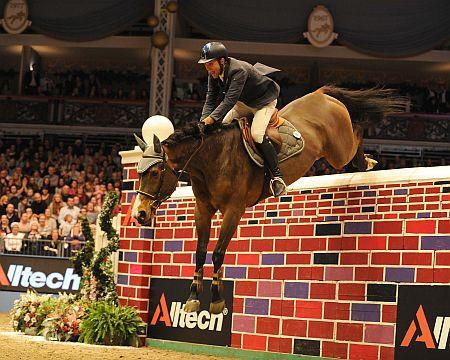 Italian rider Luca Moneta won the hearts of a packed house at Olympia, The London International Horse Show, when he cleared 7ft 2in in a thrilling Alltech Christmas Puissance