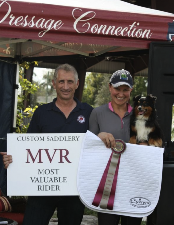 Charles Tota of The Dressage Connection presents Adrienne Lyle with the Custom Saddlery Most Valuable Rider Award.