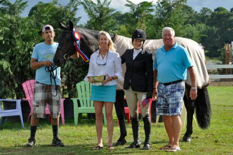 President of Classic Company, Bob Bell and Awards Coordinator Robin McPhearson, present Lynn Seithel and Versace the James Vaughn Perpetual Trophy. Flashpoint Photography