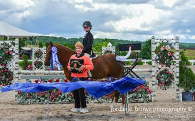 Madison Mitchell receives her HJAM Pony Medal Awards from Patricia Haines