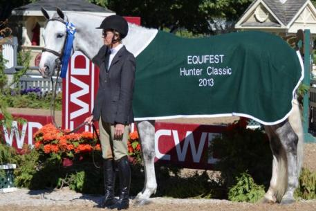 Margaret O'Meara and Voice of Reason claimed the blue in the ,000 Amateur Owner Classic at Equifest II.  Photo Credit: Brenda Mueller.