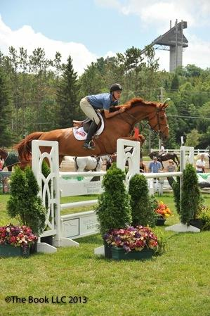 Mario Deslauriers in the Janney Montgomery Scott 1.35m class. (c) The Book LLC