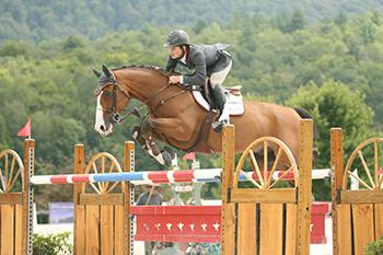 Colombia's Mark Bluman and G&C Blue won the $10,000 Theory Welcome Stake, Presented by Manchester Designer Outlets, on August 8 at the Vermont Summer Festival in East Dorset, VT. Photo by David Mullinix Photography