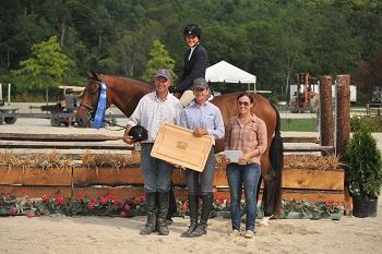 McKayla Langmeier, 13, celebrates her ,000 NEHJA Derby win with her parents, Linda Langmeier and Kenny Langmeier, and Czar-Z's groom, Rachel Thayer. Photo by David Mullinix Photography