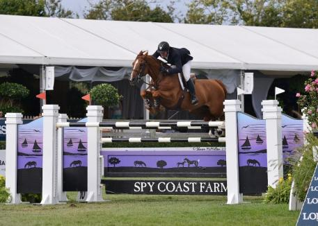 Rothchild flew over the final jump to win the 50,000 Spy Coast Farm Grand Prix Qualifier at the Hampton Classic. (Shawn McMillen photo)
