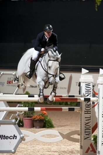 Two-time Olympic gold medalist McLain Ward jumps to victory in the 0,000 Alltech National Horse Show Grand Prix during the 2012 Alltech National Horse Show.