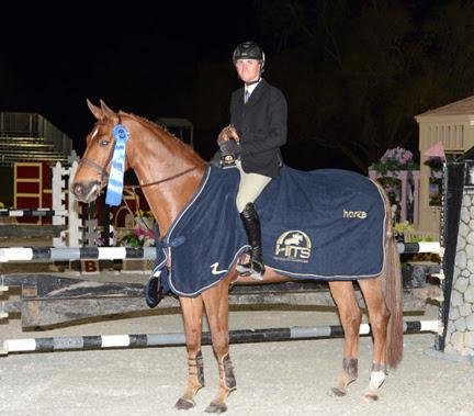 Michael Hughes accepts top honors in the HITS Equitation Championship. ©ESI Photography