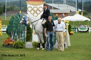 Michael Hughes after winning the WPTZ News Channel 5 1.30m class. (c) The Book LLC