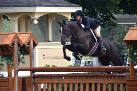 Molly McAdow and Barina, owned by Nina Donnelly, won both over fences and the under saddle in the 3' Pre-Green Hunters. Photo By: Brenda Mueller/PMG