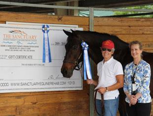 Cathy Morelli (left) and her Dutch Warmblood, BeSe, won the  Grand Prix at the Gold Coast Dressage Association's Grand Finale I show held at the Jim Brandon Equestrian Center. The class was sponsored by The Sanctuary Equine Sports Therapy & Rehabilitation Center, a world-class facility in Ocala dedicated to helping horses that compete in physically demanding sports. Morelli is joined by show manager Noreen O'Sullivan.