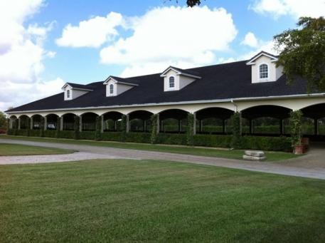 The beautiful covered arena at Stillpoint Farm in Wellington, Florida
