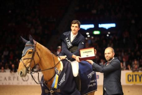 Kalle Sternberg, Brand Manager for Longines, Sweden, presents a Longines watch to Nicola Philippaerts after the young Belgian rider won the last qualifying round of the Longines FEI World Cup™ Jumping 2013/2014 Western European League at Gothenburg, Sweden today.  Photo: FEI/Roland Thunholm.