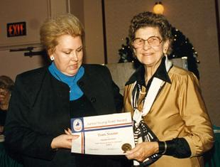 Judith Noone accepts USDF award for son Tom from Lazelle Knocke