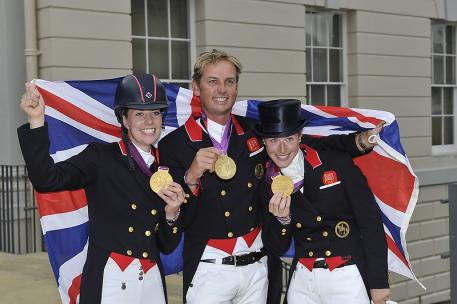 Great Britain's Charlotte Dujardin, Carl Hester and Laura Bechtosheimer won dressage team gold today at the London 2012 Olympic Games equestrian venue at Greenwich Park. (Photo: FEI/Kit Houghton)