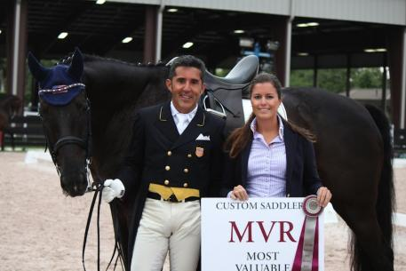 Custom Saddlery's final MVR winner of the 2014 season, Dr. Cesar Parra is presented with his award by Cora Causemann