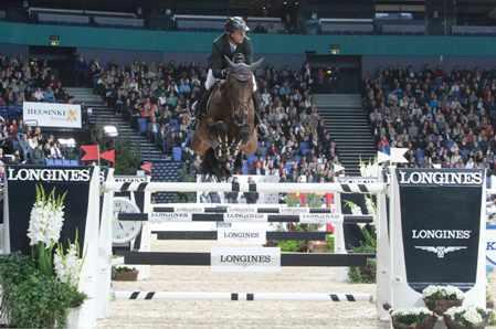The French partnership of Patrice Delaveau and Orient Express HDC on their way to victory in the second leg of the Longines FEI World Cup™ Jumping Western European League 2013/2014 series at Helsinki, Finland today.  Photo: FEI/Annette Boe Østergaard